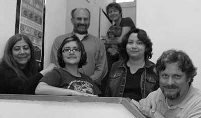 SRIC Staff 2006-Left to Right: Sofia Martinez, Elisa Pintor, Paul Robinson, Annette Aguayo and Chris Shuey. (Rear) Citizen Action Director Sue Dayton (holding Roxy).  Not pictured:  Micheal Cling, Michael Dunagan, Don Hancock, Sarah Henio-Adeky, and Sarah Myers.